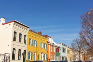 a row of painted brick homes
