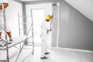 professional painter painting gray walls