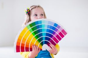 kid with color swatches